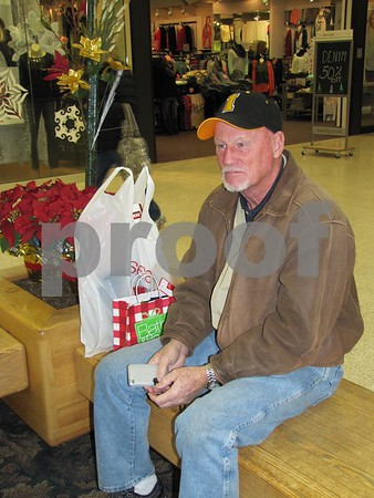Dick Messerly takes a break from shopping while waiting for his family.