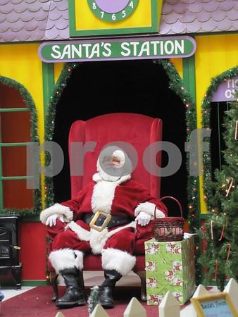 Santa waits for the next visitor.