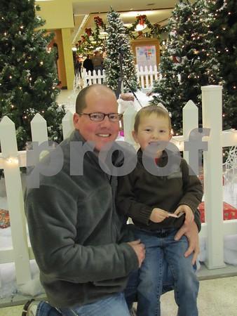 Ryan and Calahan Reisner outside Santa's station at the Crossroads Mall.