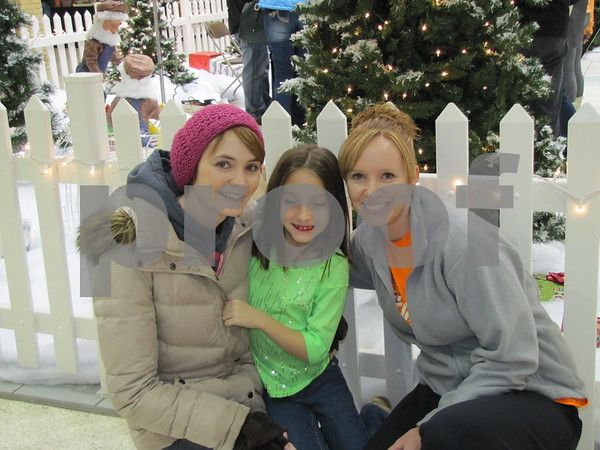 Amber Oakes, Gracie Jones, and Trish Sturtz enjoying the warm holiday atmosphere at the Crossroads Mall.