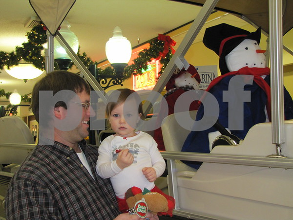 Lucas and Kinley Vote inspect the snow-people who appeared to be driving the speed boat on display.