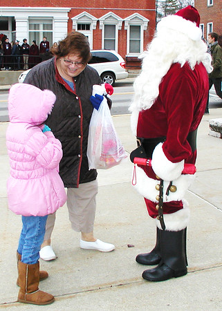 Diane Raver | The Herald-Tribune<br /> Santa greeted visitors throughout the town.