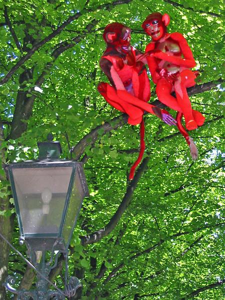 monkeys on tree by lamp open air art