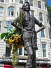 statue of boy, with flowers