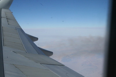 View out of the window over China, with B747 exhaust