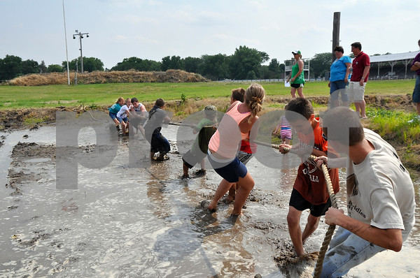-Messenger photo by Joe Sutter<br /> <br /> The 10-18 year old contestants try their hand at a muddy tug-of-war following the Barnyard Olympics at the Humboldt Sesquicentennial celebration Sunday. <br /> <br /> After the 4-H sponsored Barnyard Olympics, participants took