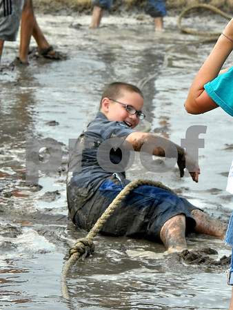 -Messenger photo by Joe Sutter<br /> <br /> Jaden Frazier, 10, picks himself up out of the mud after a bout of tug-of-war at the Humboldt Sesquicentennial celebration Sunday.