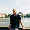 Me standing on the Charles Bridge of Prague with the Vltava River in the background