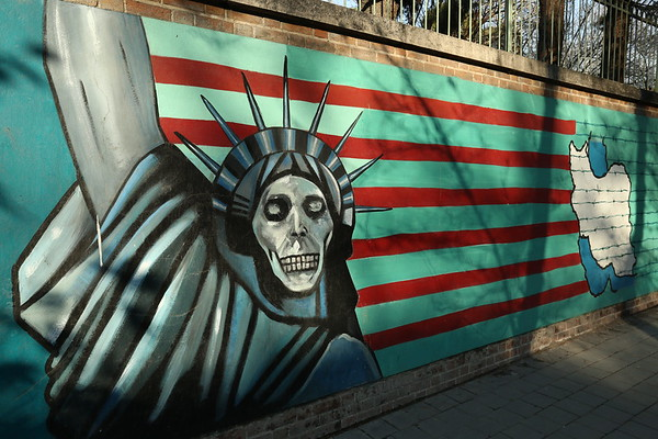 """United States Embassy was closed after the Iran hostage crisis from 1979. The name used by many Iranians for the building is """"espionage den"""" or """"den of spionage"""". The brick walls around the perimeter are covered with anti-American murals commissioned by the Iranian government."""
