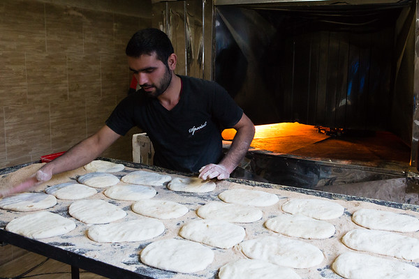 I was looking for food after returning to Masuleh. When the baker saw me he immediately invited me in his bakery. He was speaking little English but was feeling honoured to see me there. I was also very happy to see how they make those amazing breads and take some pictures while thinking this would be impossible to do Western Countries due to regulations.