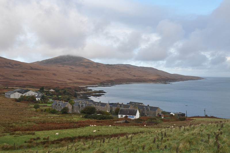 Bonahaven from the South East. The white house nearest the camera is the 'new' schoolhouse, now unoccupied. A 'new' school next to the schoolhouse was built in the 1970s and demolished several years ago. At its peak there were 43 pupils and two teachers. Now there are no children of school age living in Bonahaven. It's almost become a ghost village.