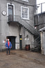 Ian stands beneath the steps leading to his Dad's old office at Bunnahabhain Distillery