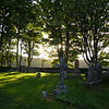 June 2010. Evening sunlight at Kildalton Chapel graveyard.