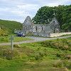June 2010. Kildalton chapel and Celtic crosses with 21st-century intrusion.