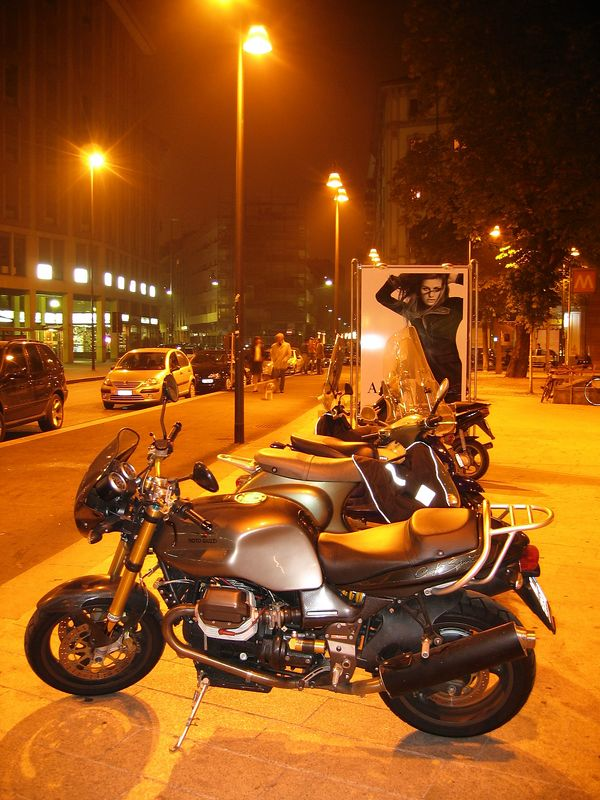 Close to Piazza 25 Aprile. <br /> Scooters, Moto Guzzi V11 Cafe Sport -Nuda ed elegante- and publicity for Armani: defenitely Italy!
