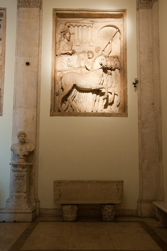 "This relief is from the triumphal Arc dedicated to Marcus Aurelius to the occasion of its victory over the Sarmatians and Germans (176 A.D.). <br /> It represents the imperial triumph. The emperor enters Rome in a chariot pulled by horses, followed by a ""wingged victory"".<br /> Musei capitolini, Rome, Italy."