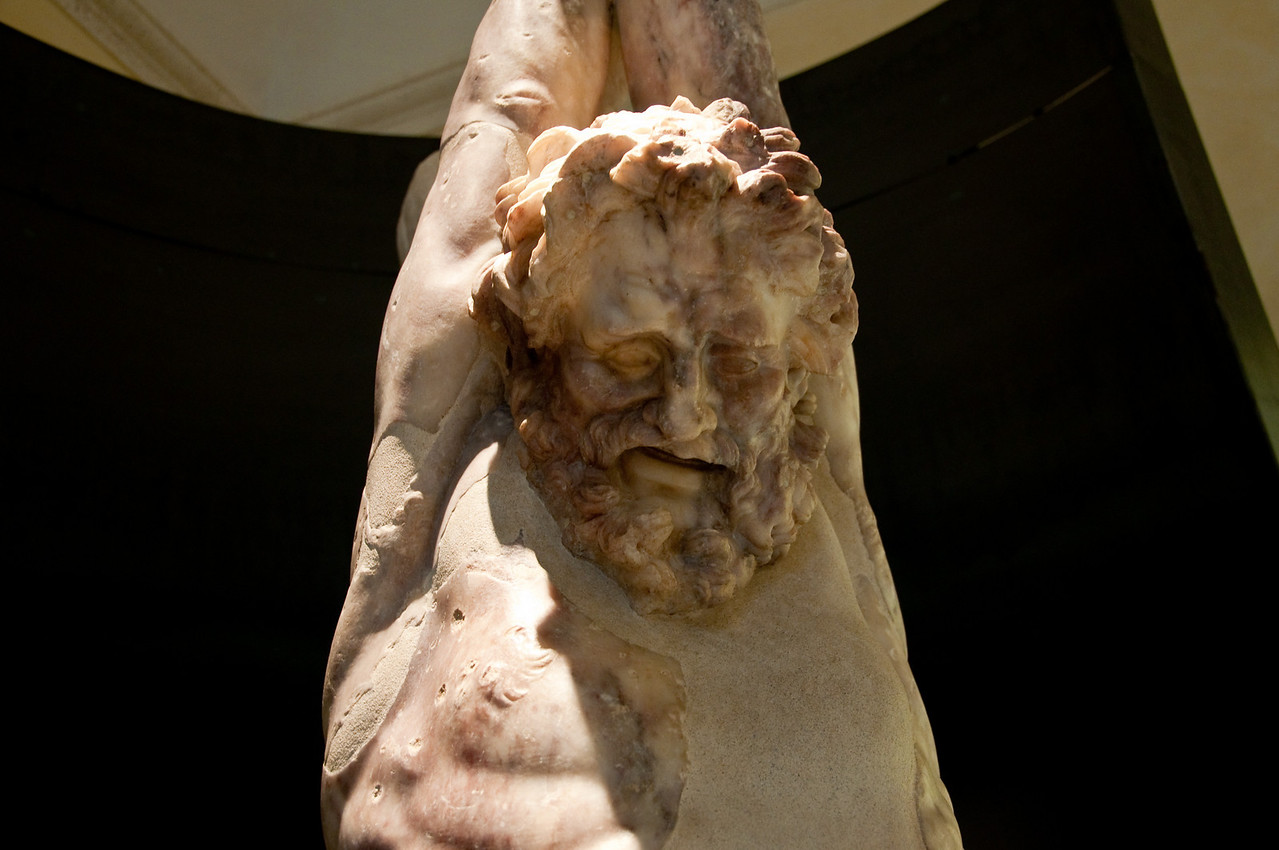 A closeup on the face of the statue of Marsyas. Capitoline Museums, Rome Italy.