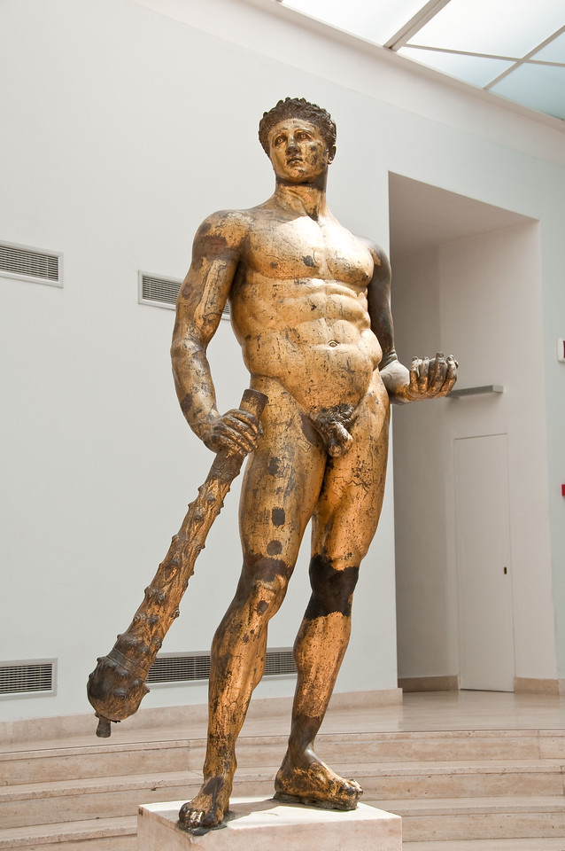 Hercules (gilded bronze, 2nd century BD). The stature features two of Hercule's identifying symbols : his club and the golden apples of the Hesperides. Capitoline Museums, Rome Italy.