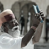 Old man taking photos with smartphone.