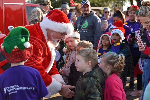 Santa visits with children at the 3rd annual Jacksonville Jingle Jog hosted by CHRISTUS Mother Frances. (Jessica T. Payne/Tyler Morning Telegraph)