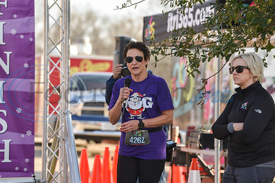 CHRISTUS Mother Frances – Jacksonville Chief Operating Officer Anne Pileggi welcomes runners to the 3rd annual Jacksonville Jingle Jog on Saturday. Proceeds from the event go to the local Rotary Club's scholarship fund which supports Jacksonville High School graduating seniors that are seeking to further their education after graduation. (Jessica T. Payne/Tyler Morning Telegraph)