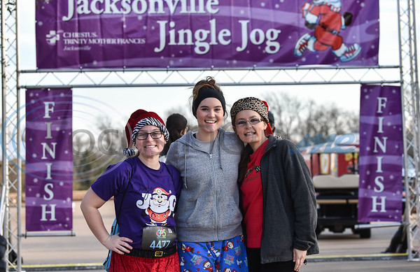 Sister (from left) Ali, Chloe and Abi Carnes attend the 3rd annual Jacksonville Jingle Jog. The event, hosted by CHRISTUS Mother Frances, included a 5K, food vendors, kids fun run, and pictures with Santa who arrived by helicopter. (Jessica T. Payne/Tyler Morning Telegraph)