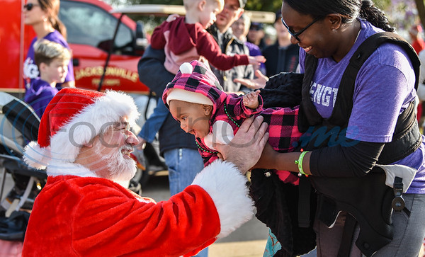 Kamryn Baxter, 7 months, is all smiles while meeting Santa at the 3rd annual Jacksonville Jingle Jog on Saturday. The Jacksonville event also included a Fun Run for children. (Jessica T. Payne/Tyler Morning Telegraph)