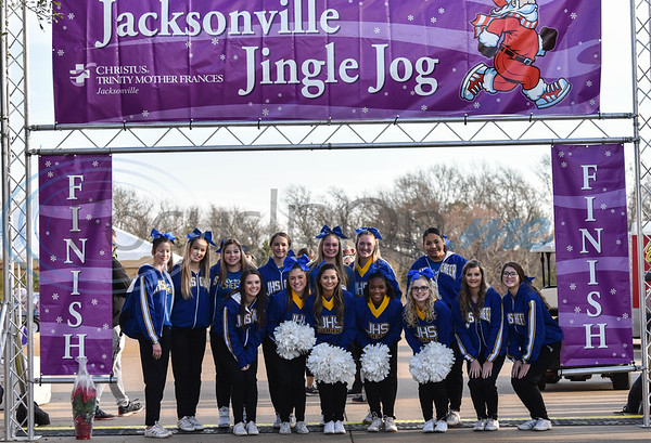 The Jacksonville High School cheerleaders were on hand to cheer runners to the finish line at the 3rd annual Jacksonville Jingle Jog on Saturday sponsored by CHRISTUS Mother Frances. (Jessica T. Payne/Tyler Morning Telegraph)