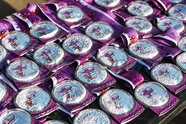 Jacksonville Jingle Jog participants received a snow globe metal upon completing the 5K on Saturday, December 7. The event, in its 3rd year, is hosted by CHRISTUS Mother Frances. (Jessica T. Payne/Tyler Morning Telegraph)