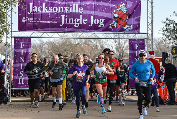 Runner take off at the 3rd annual Jacksonville Jingle Jog on Saturday, December 7. The event, hosted by CHRISTUS Mother Frances, also included food vendors, kids fun run, and pictures with Santa who arrived by helicopter. (Jessica T. Payne/Tyler Morning Telegraph)