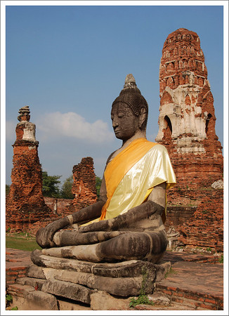 Many of the Buddhist statues were draped in orange material.