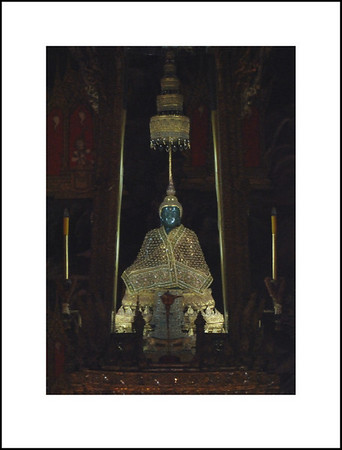 The Emerald Buddha.  We couldn't use our cameras inside the building, so I had to take this looking through the doorway with my 70 -300mm lens @ 300mm.  Very high ISO, so it is very noisy.