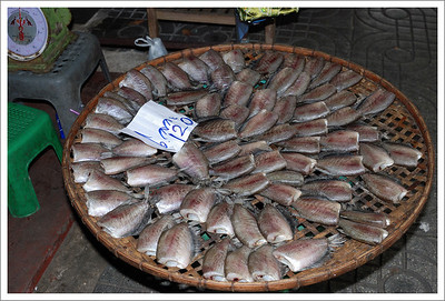 Fresh fish for sale.  The sign says 6 for 120 baht, which is about $3.60.