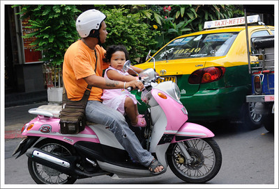 There were many children riding on bicycles and motorbikes.