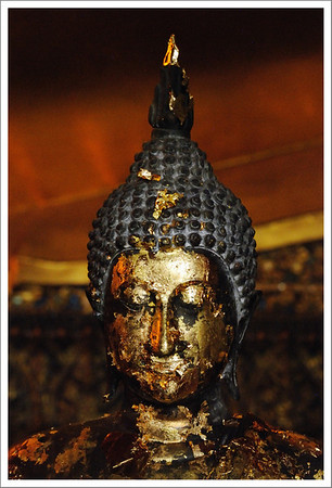 More gold leaf for Buddha.