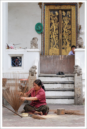 This lady was making brooms in front of this temple