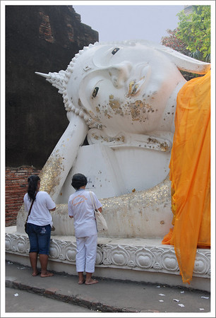 We saw 2 reclining Buddhas.  This one was out doors.  You can purchase gold leaf to apply to the statue.  You must remove your hat and shoes and make sure your upper arms and legs are covered when you approach these monuments.