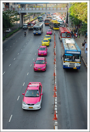 Very colorful buses and taxis.