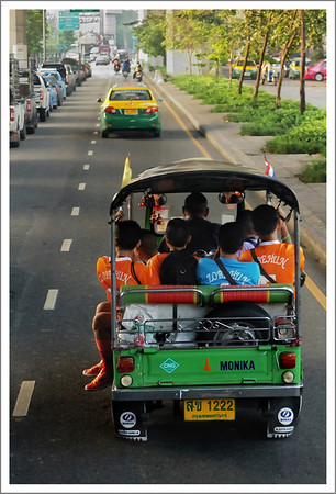 We rode in one of these tricycle taxis back to our hotel.  They are designed for 2 passengers, but we often saw many crammed in.  This one has 6 passengers plus the driver.  They zip around pretty fast too.