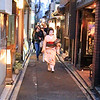Geisha off to work in Pontocho Alley, Kyoto