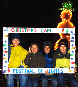 "Debbie Blank | The Herald-Tribune Oldenburg brothers (from left) Luke, 11; Ryan, 6; Jack, 8; and Will Pulskamp, 14, pose in the selfie area. Of the Festival of Lights, Luke reported, ""It's awesome!"""