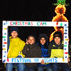 "Debbie Blank | The Herald-Tribune<br /> Oldenburg brothers (from left) Luke, 11; Ryan, 6; Jack, 8; and Will Pulskamp, 14, pose in the selfie area. Of the Festival of Lights, Luke reported, ""It's awesome!"""