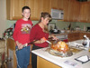 Mathew and Pam get Tom the Turkey ready for the Christmas feast.