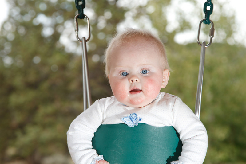 Katie's enjoys her new swing at Grandma Jennifer's chalet in Central Oregon