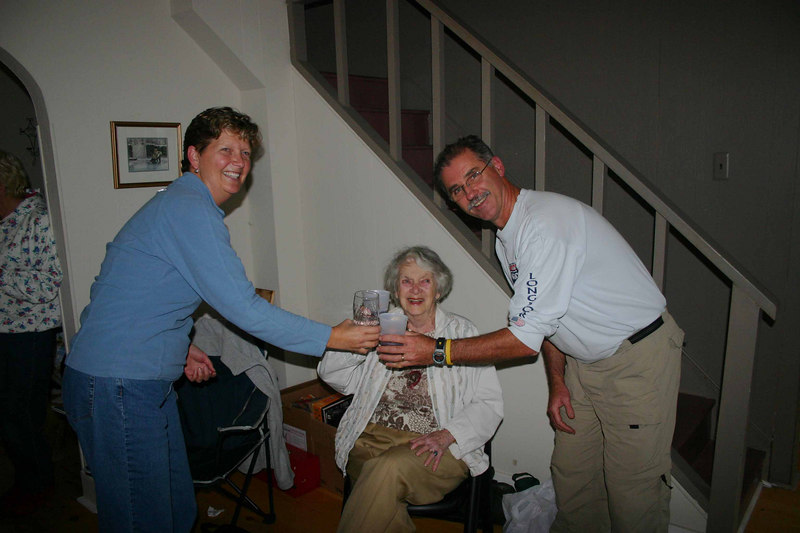 Mom toasts Michelle and Jeff's purchase.