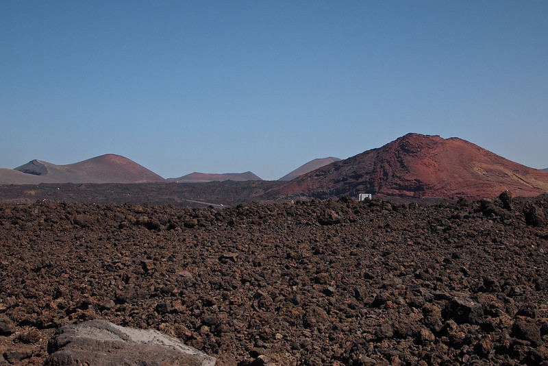 Looking from the cliffs back over at Lanzarote's volcanic landscape.