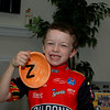 Zac shows his ceramic cereal bowl -- hand-painted by Katie.
