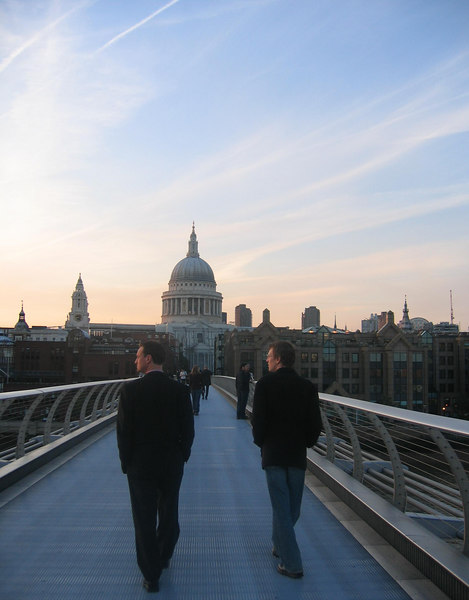 Men in Black walking over the Millennium Bridge towards St Pauls