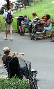 Man playing Trumpet in the Park