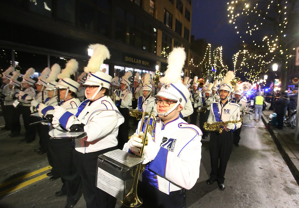 . UMass Lowell marching band in Lowell City of Lights parade. (SUN/Julia Malakie)